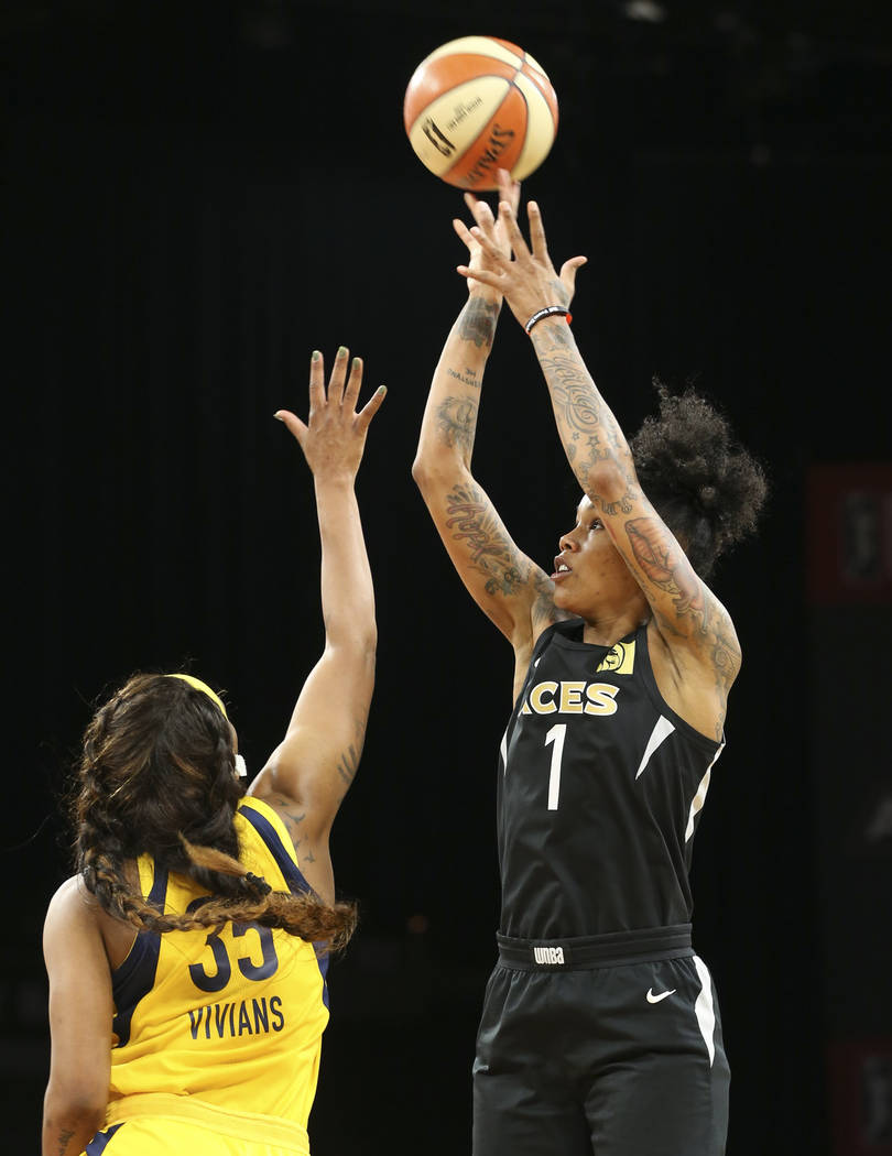 Las Vegas Aces forward Tamera Young (1) takes a shot over Indiana Fever guard Victoria Vivians (35) during the first half of a WNBA basketball game at the Mandalay Bay Events Center on Saturday, A ...