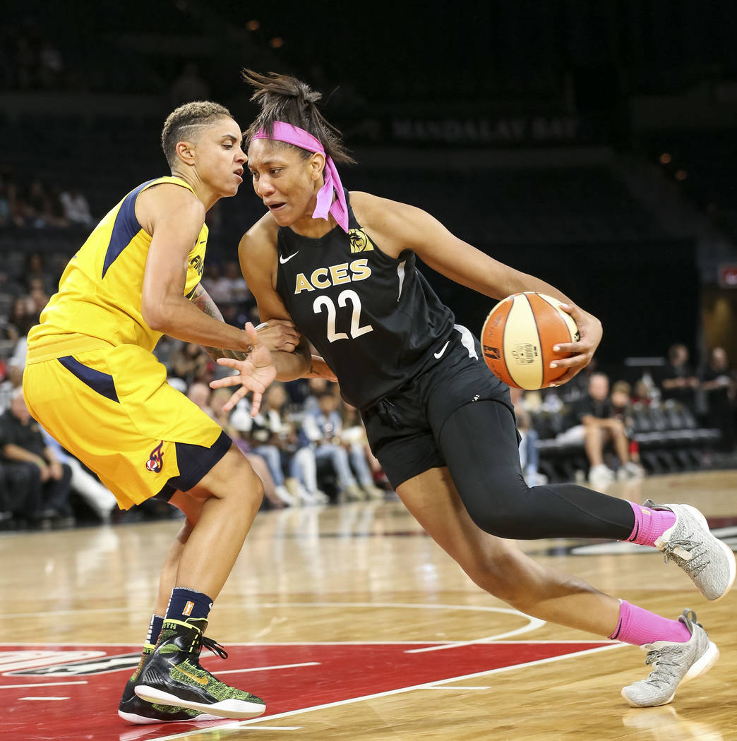 Las Vegas Aces center A'ja Wilson (22) drives the ball against Indiana Fever forward Candice Dupree (4) during the first half of a WNBA basketball game at the Mandalay Bay Events Center on Saturda ...