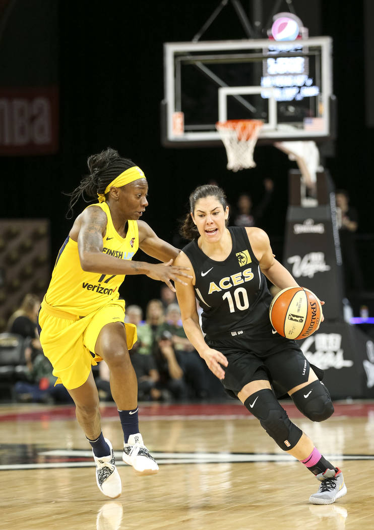 Las Vegas Aces guard Kelsey Plum (10) drives the ball past Indiana Fever guard Erica Wheeler (17) during the first half of a WNBA basketball game at the Mandalay Bay Events Center on Saturday, Aug ...