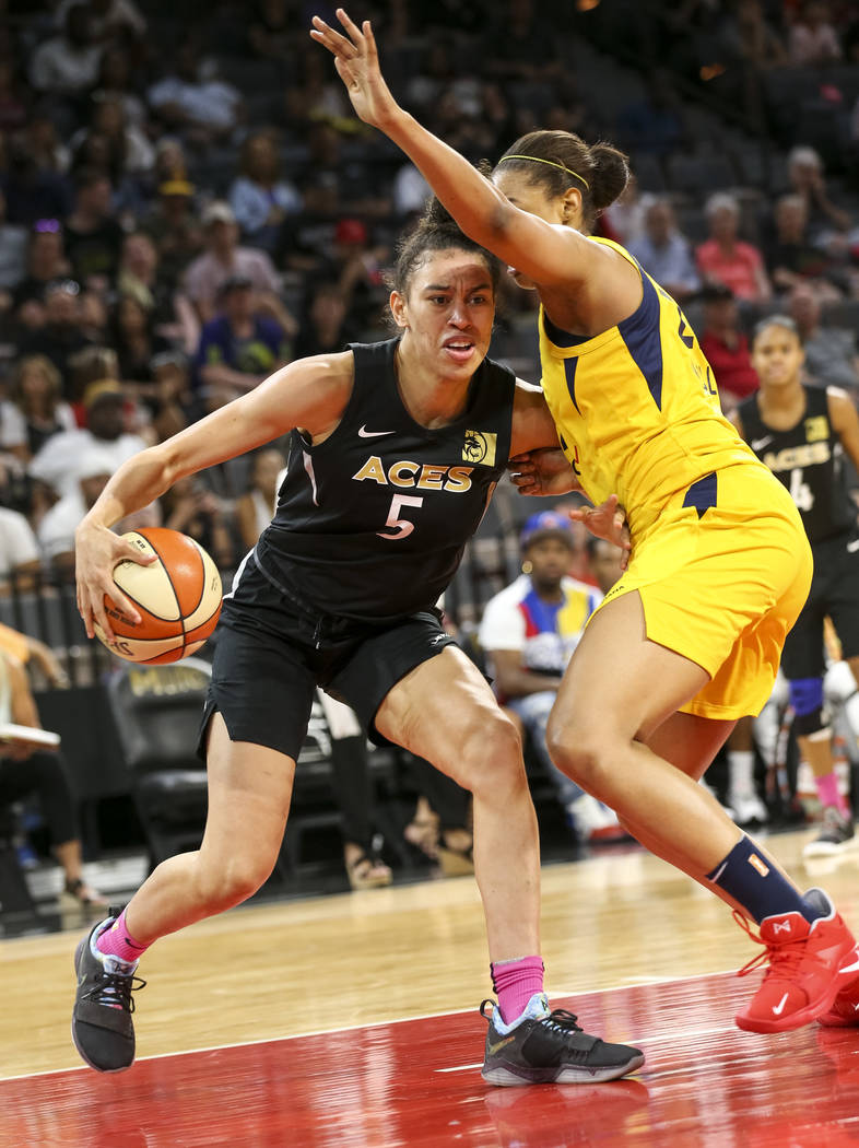 Las Vegas Aces forward Dearica Hamby (5) drives the ball against Indiana Fever forward Erica McCall (22) during the second half of a WNBA basketball game at the Mandalay Bay Events Center on Satur ...