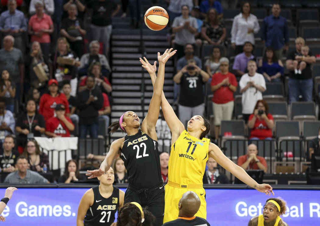 Las Vegas Aces center A'ja Wilson (22) and Indiana Fever forward Natalie Achonwa (11) tip off at the start of a WNBA basketball game at the Mandalay Bay Events Center on Saturday, Aug. 11, 2018. R ...