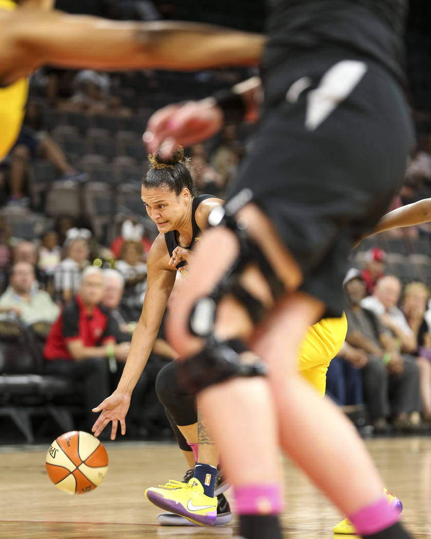 Las Vegas Aces guard Kayla McBride (21) drives the ball against the Indiana Fever during the first half of a WNBA basketball game at the Mandalay Bay Events Center on Saturday, Aug. 11, 2018. Rich ...