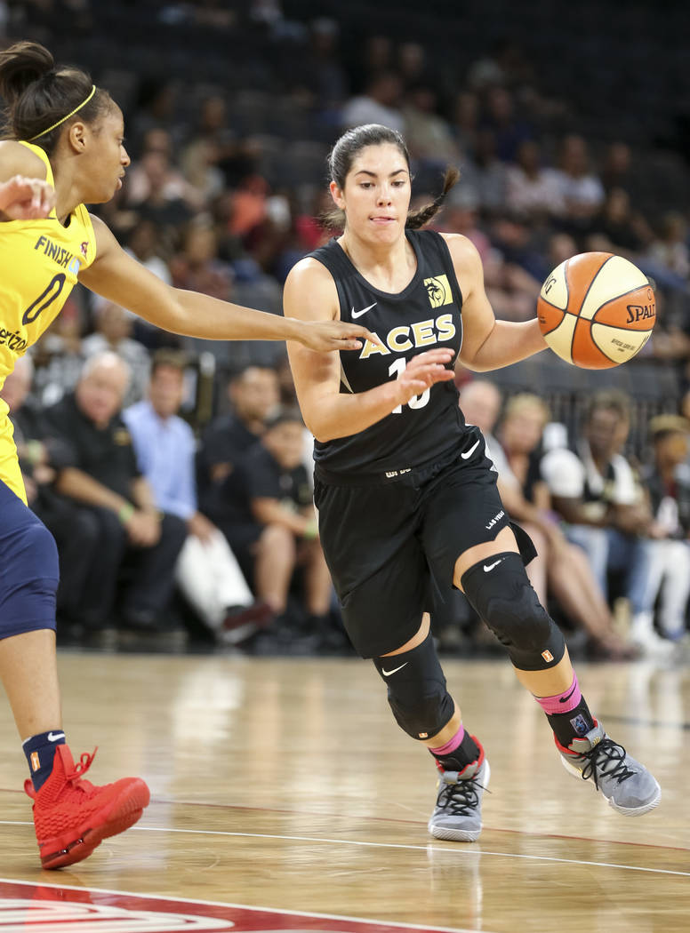 Las Vegas Aces guard Kelsey Plum (10) drives the ball past Indiana Fever guard Kelsey Mitchell (0) during the first half of a WNBA basketball game at the Mandalay Bay Events Center on Saturday, Au ...