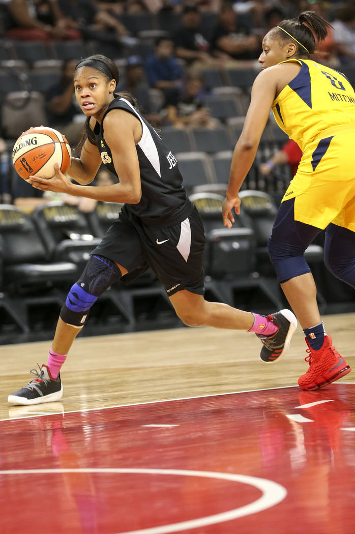 Las Vegas Aces guard Moriah Jefferson (4) drives the ball past Indiana Fever guard Kelsey Mitchell (0) during the first half of a WNBA basketball game at the Mandalay Bay Events Center on Saturday ...