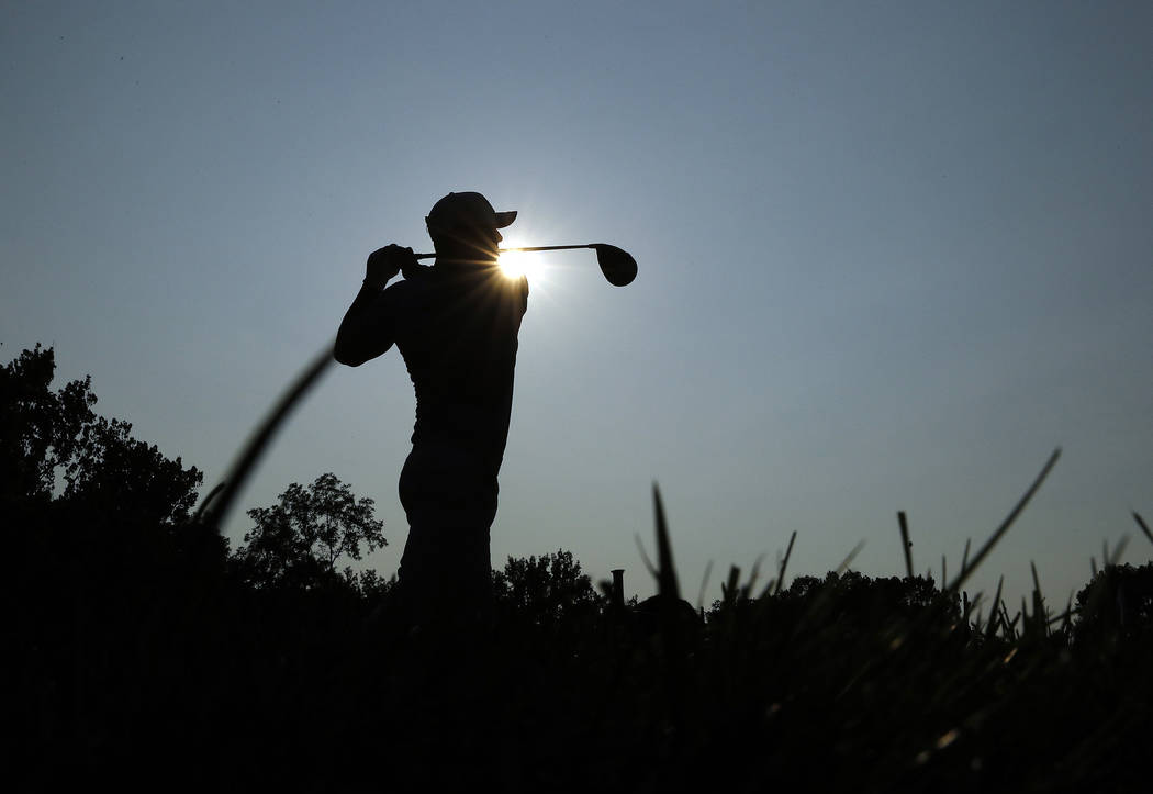 Brooks Koepka tees off on the 18th hole during the third round of the PGA Championship golf tournament at Bellerive Country Club, Saturday, Aug. 11, 2018, in St. Louis. (AP Photo/Charlie Riedel)