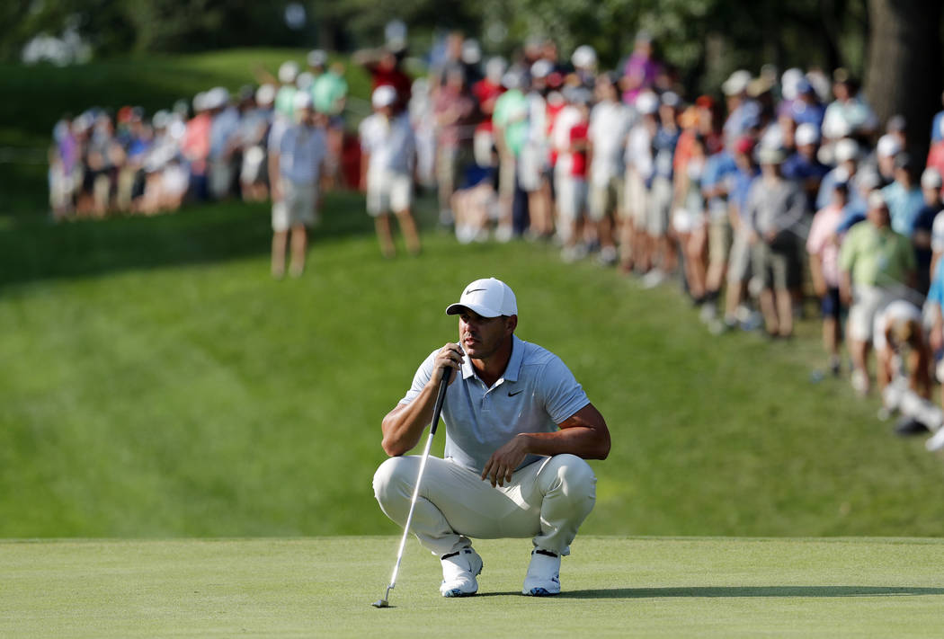 Brooks Koepka waits to putt on the 15th green during the third round of the PGA Championship golf tournament at Bellerive Country Club, Saturday, Aug. 11, 2018, in St. Louis. (AP Photo/Jeff Roberson)