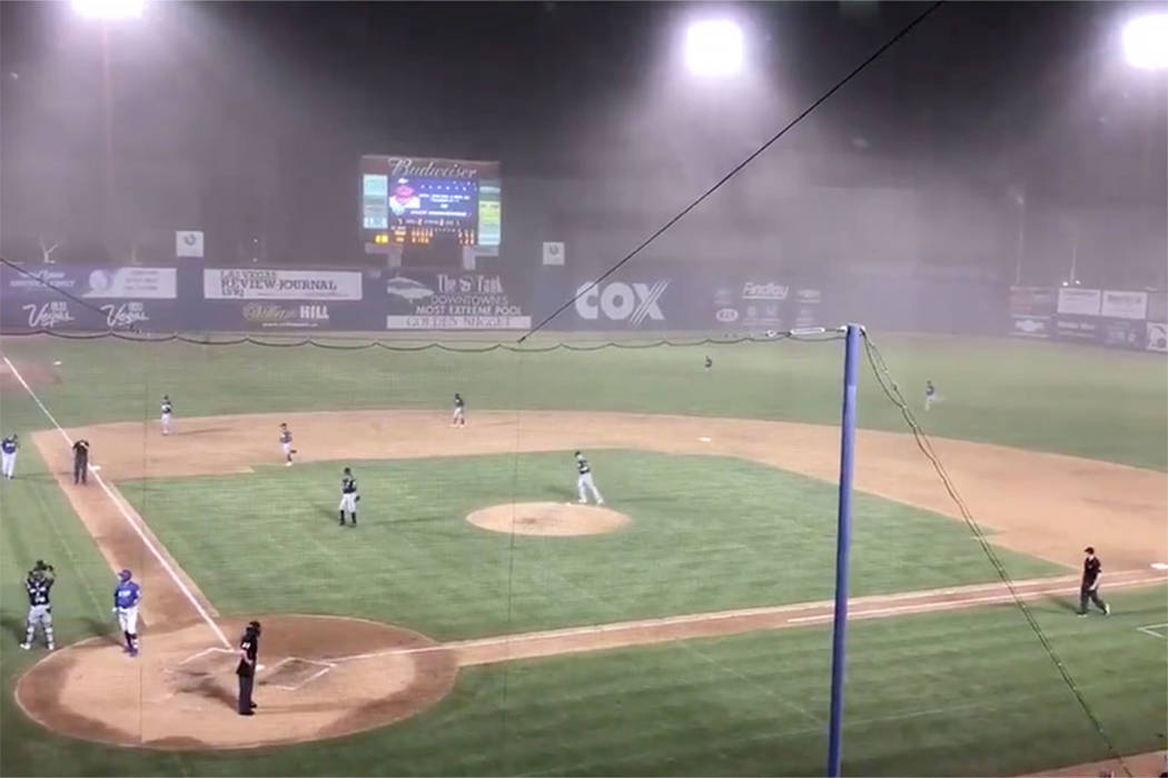 Players leave Cashman Field during a dust storm Saturday, Aug. 11, 2018, in Las Vegas. (Betsy Helfand/Las Vegas Review-Journal)