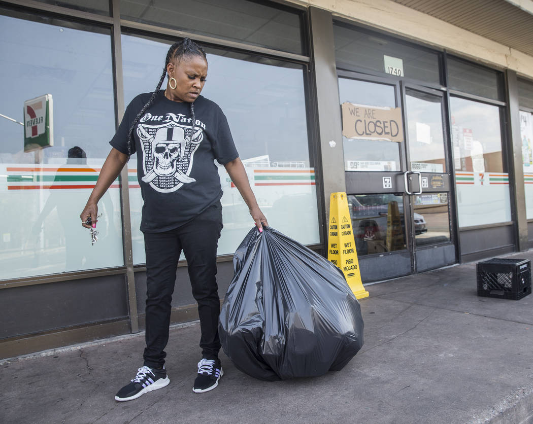 711 cashier Gilda Cook throws out produce that was lost after power was knocked out at the convenience store on Fremont Street and Bruce Street on Sunday, Aug., 12, 2018, in Las Vegas. More than 6 ...