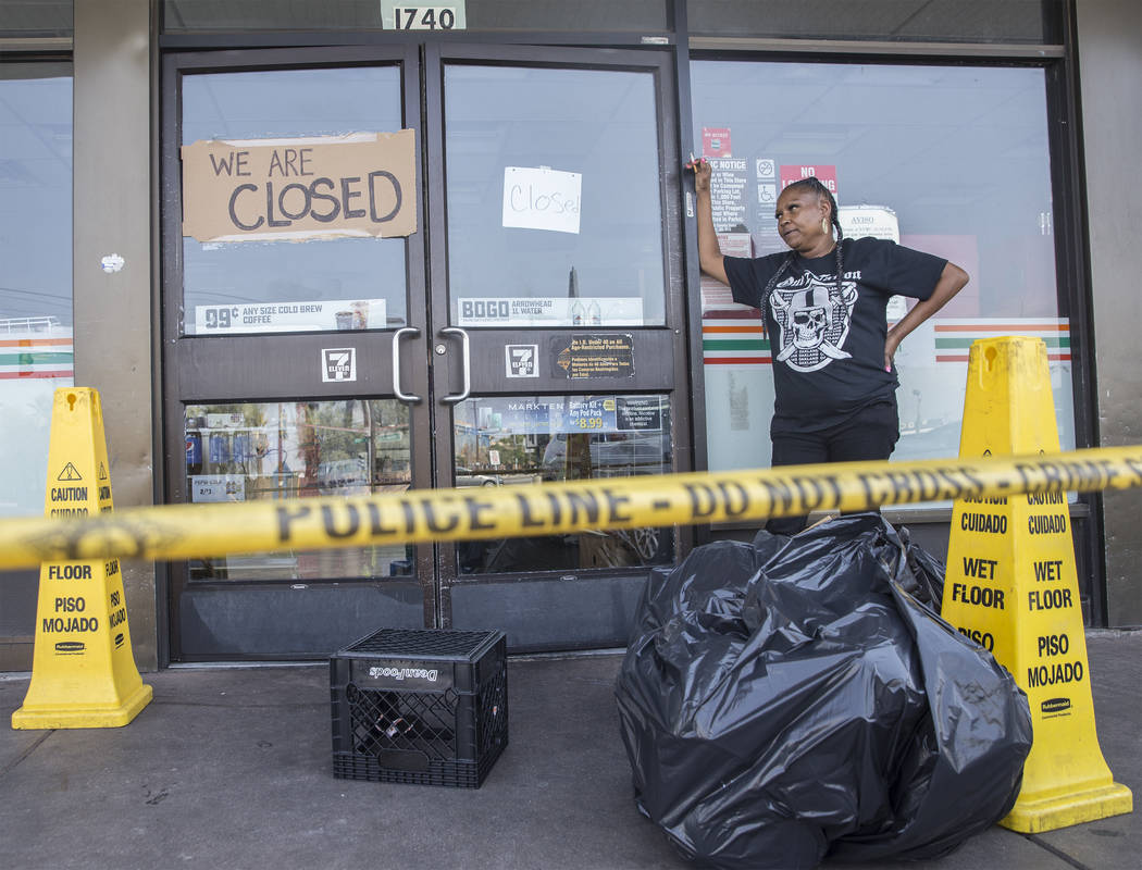 711 cashier Gilda Cook takes a break from throwing out produce that was lost after power was knocked out at the convenience store on Fremont Street and Bruce Street on Sunday, Aug., 12, 2018, in L ...