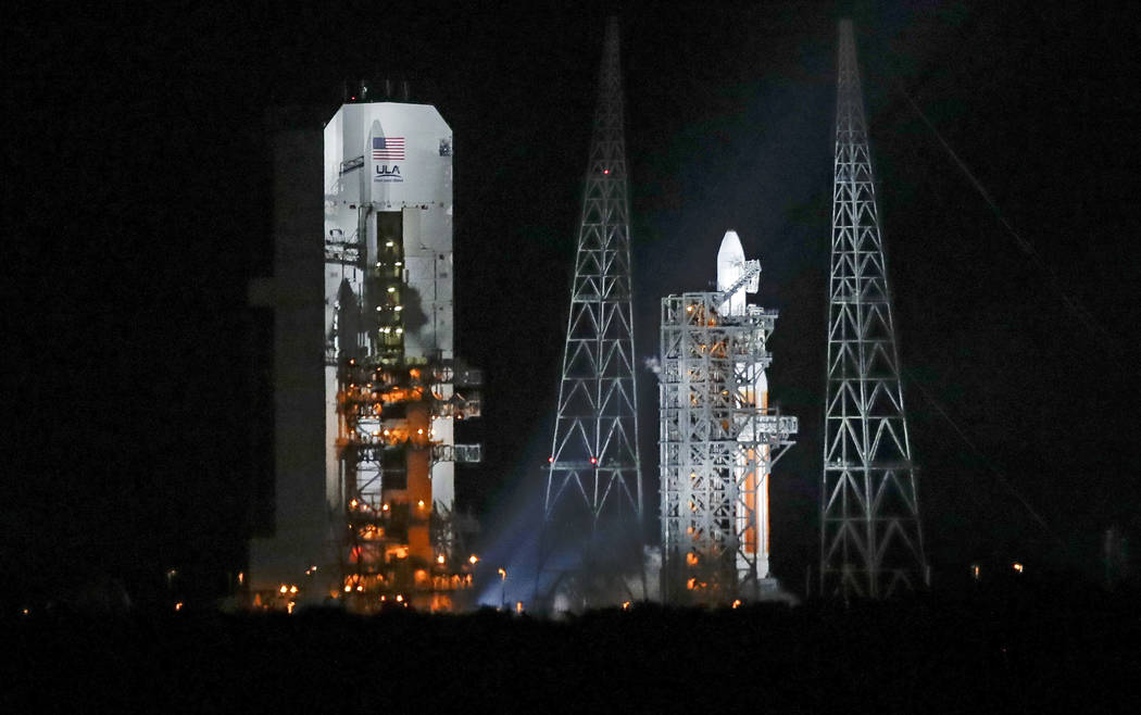 A Delta IV rocket, carrying the Parker Solar Probe, stands on launch complex 37 after the launch was scrubbed at the Kennedy Space Center, Saturday, Aug. 11, 2018, in Cape Canaveral, Fla. The Park ...