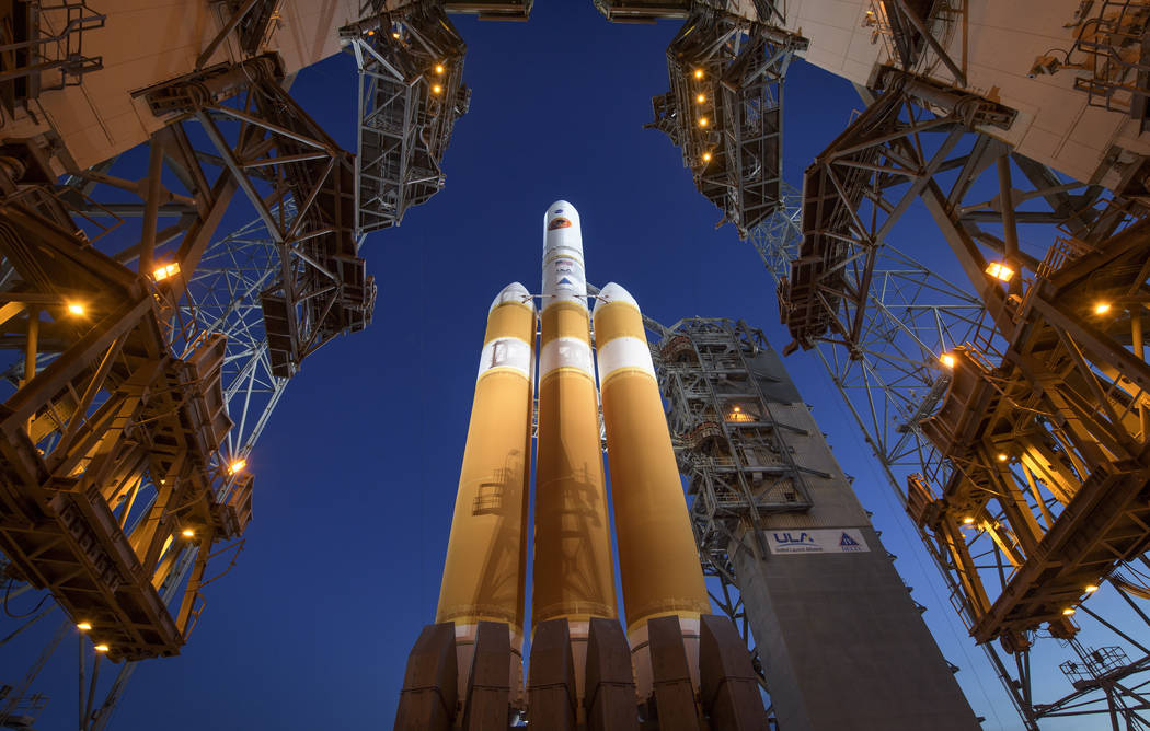The Mobile Service Tower is rolled back to reveal the United Launch Alliance Delta IV Heavy rocket with the Parker Solar Probe onboard, Saturday, Aug. 11, 2018, Launch Complex 37 at Cape Canaveral ...