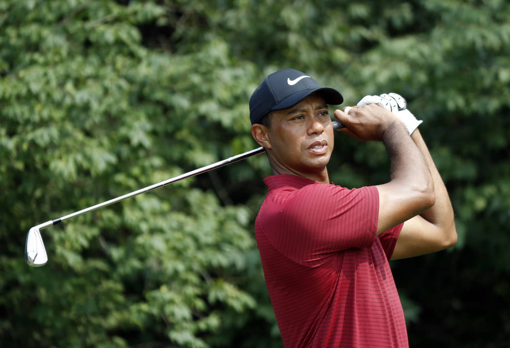 Tiger Woods watches his tee shot on the ninth hole during the final round of the PGA Championship golf tournament at Bellerive Country Club, Sunday, Aug. 12, 2018, in St. Louis. (AP Photo/Brynn An ...