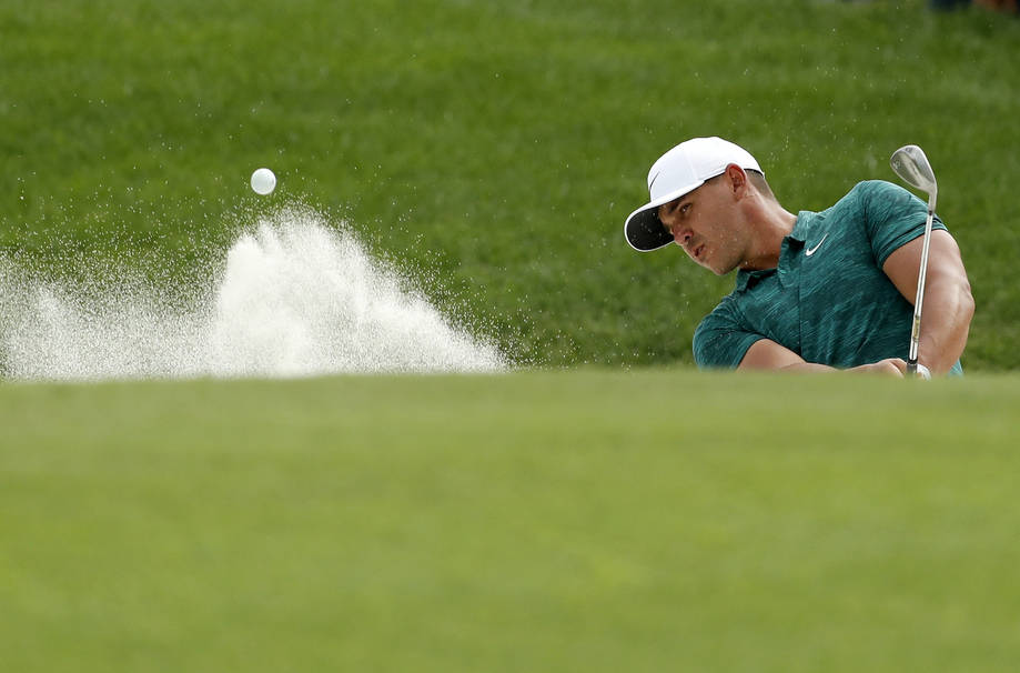 Brooks Koepka hits out of a bunker on the 10th hole during the final round of the PGA Championship golf tournament at Bellerive Country Club, Sunday, Aug. 12, 2018, in St. Louis. (AP Photo/Jeff Ro ...