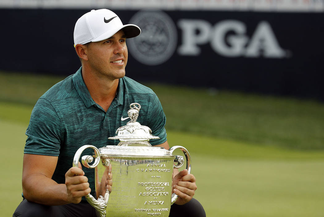 Brooks Koepka poses with the Wanamaker Trophy after winning the PGA Championship golf tournament at Bellerive Country Club, Sunday, Aug. 12, 2018, in St. Louis. (AP Photo/Charlie Riedel)