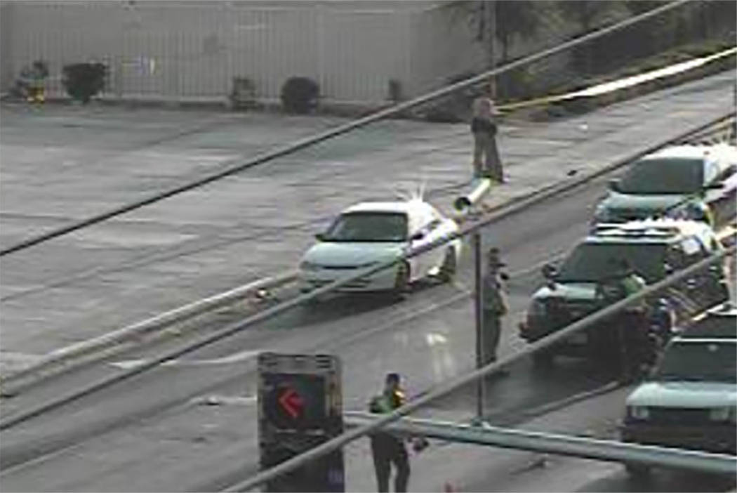 Police investigate after a pedestrian was hit by two vehicles at the intersection of Sahara Avenue and Las Vegas Boulevard South on Sunday in Las Vegas. (screengrab/RTC fast cameras)