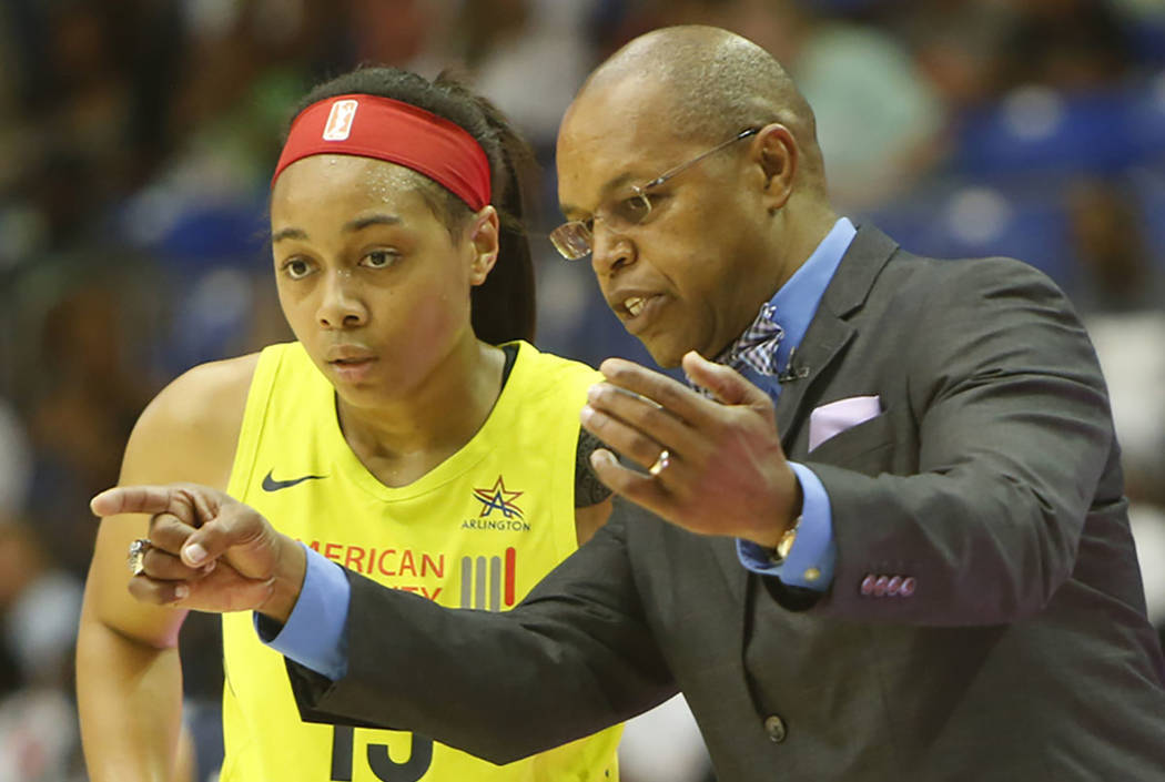 Dallas Wings guard Allisha Gray, left, listens to head coach Fred Williams during a break in WNBA basketball game action in the second half against the Washington Mystics, Thursday, July 19, 2018, ...