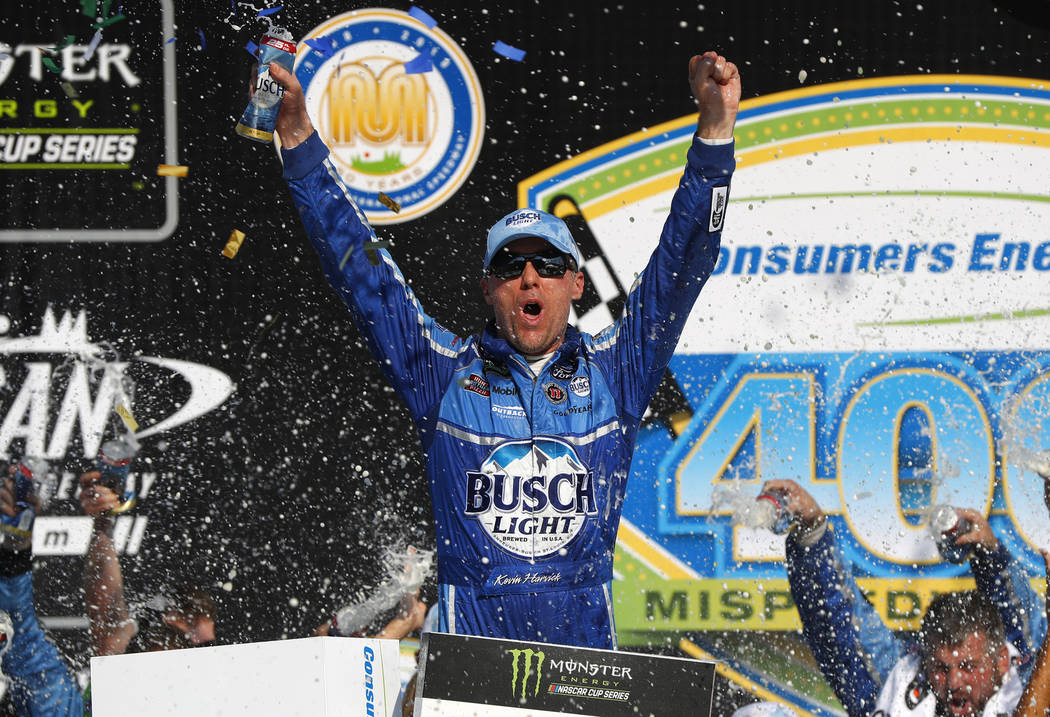 Kevin Harvick celebrates his victory after a NASCAR Cup Series auto race at Michigan International Speedway in Brooklyn, Mich., Sunday, Aug. 12, 2018. (AP Photo/Paul Sancya)