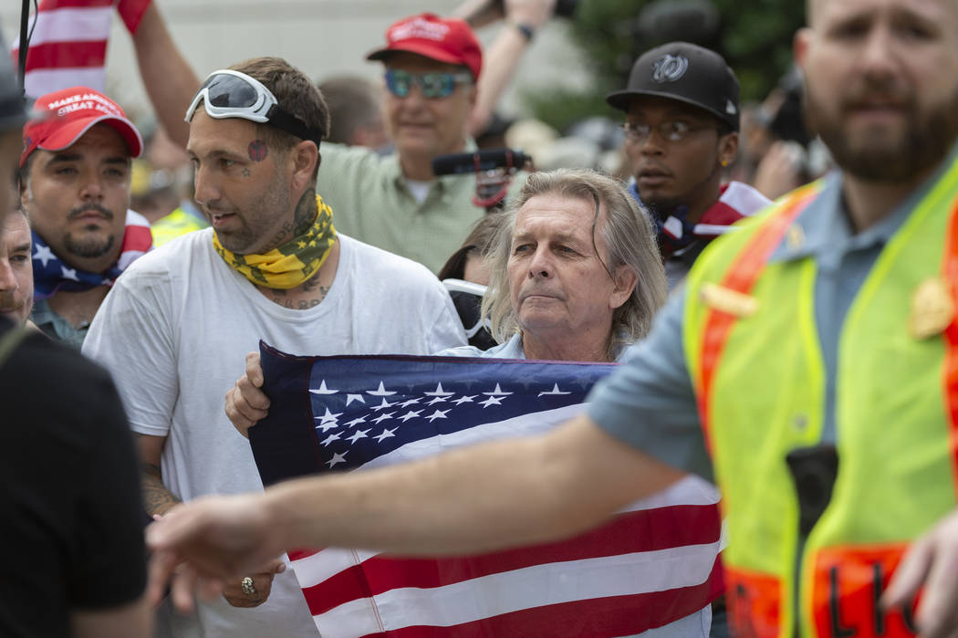 """White nationalists march to Lafayette Square during the """"Unite the Right 2"""" rally in Washington, Sunday, Aug. 12, 2018. (Craig Hudson/Charleston Gazette-Mail via AP)"""