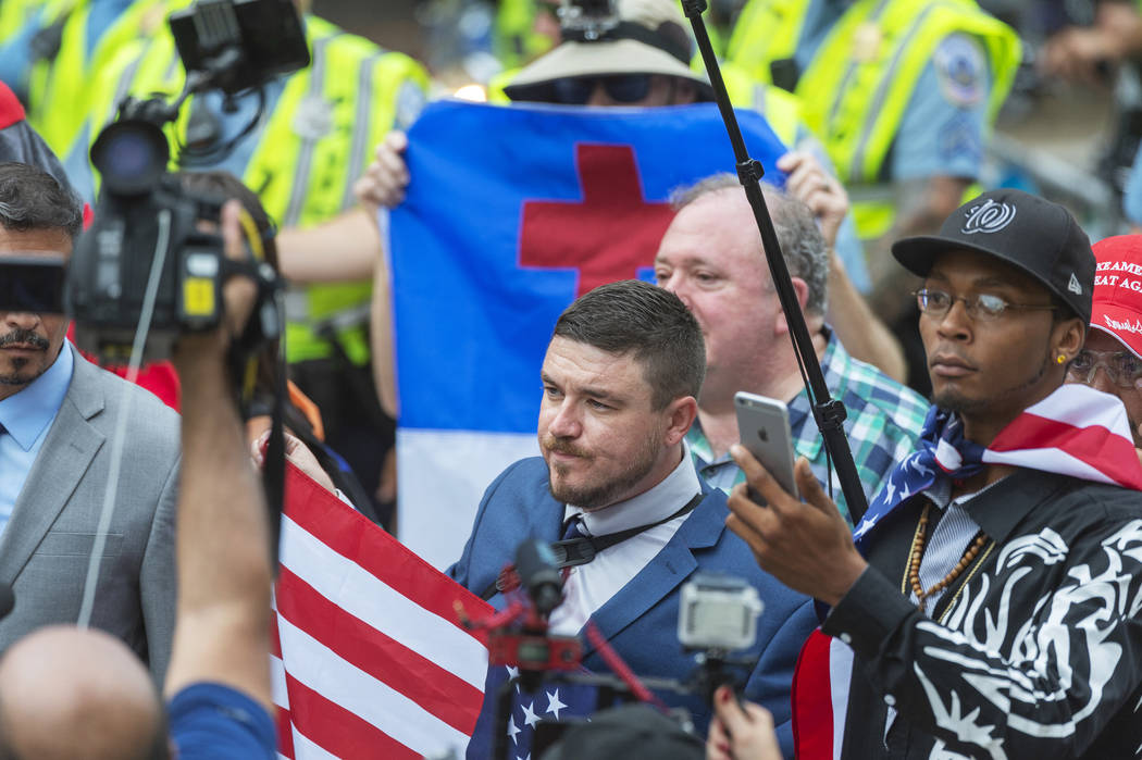 """Jason Kessler, center, marches with other white nationalists to Lafayette Square during the """"Unite the Right 2"""" rally in Washington, Sunday, Aug. 12, 2018. (Craig Hudson/Charleston Gazet ..."""