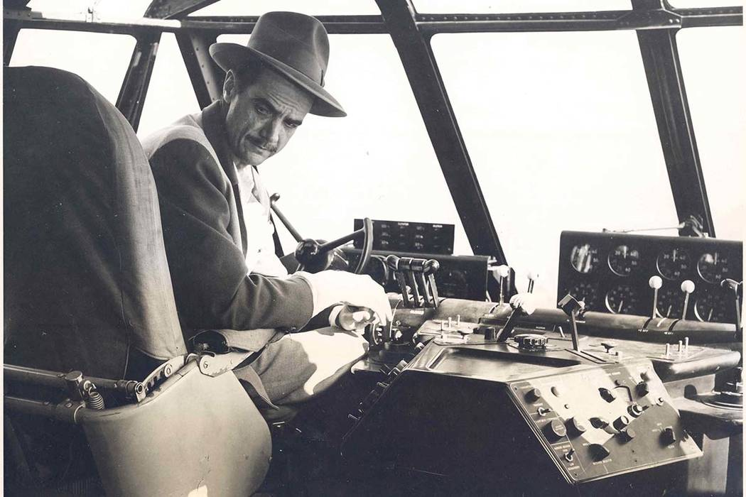Businessman and aviator Howard Hughes sits in the cockpit of the H-4 Hercules (Spruce Goose) sea plane in the waters off Long Beach, California on Nov. 2, 1947, prior to taking the massive 8-engin ...