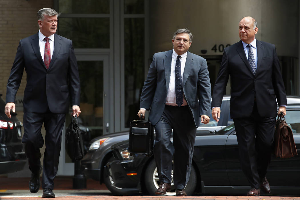 Members of the defense team for Paul Manafort, including Kevin Downing, left, Richard Westling, and Thomas Zehnle, walk to federal court as the trial of the former Trump campaign chairman continue ...
