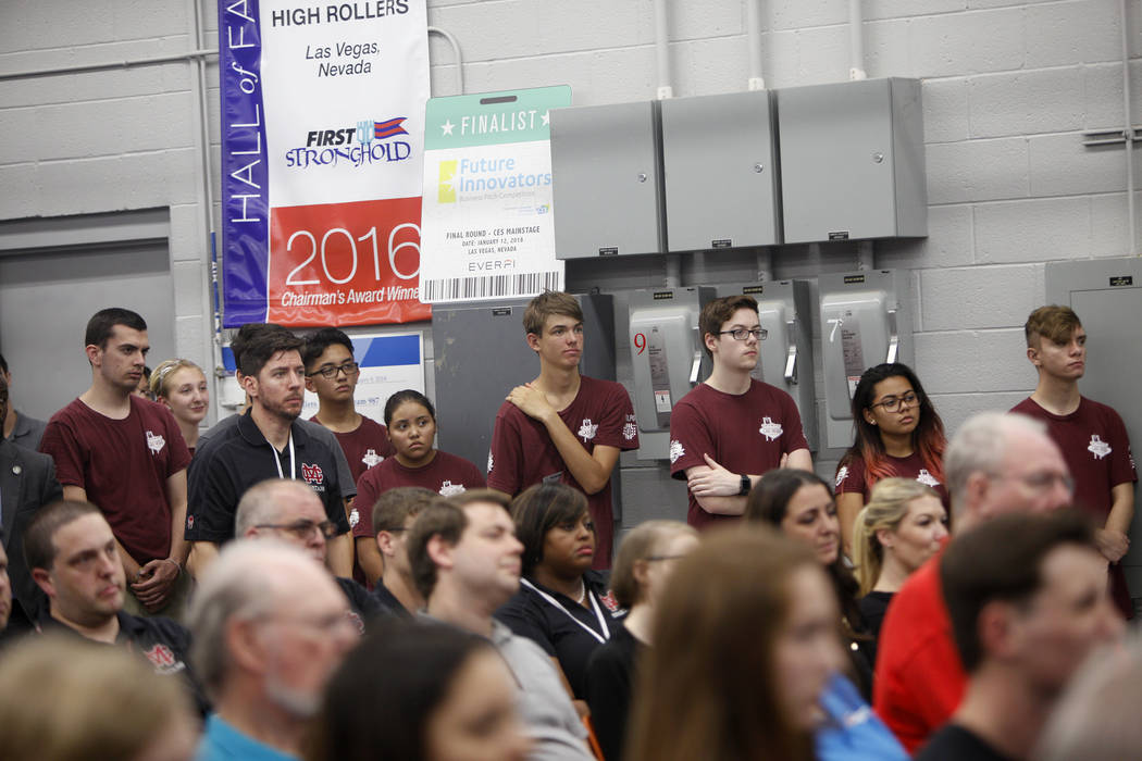 Students in Cimarron-Memorial's robotics program stand and listen at an event where Tesla and education leaders revealed new opportunities for robotics for education throughout the state at Cimarr ...
