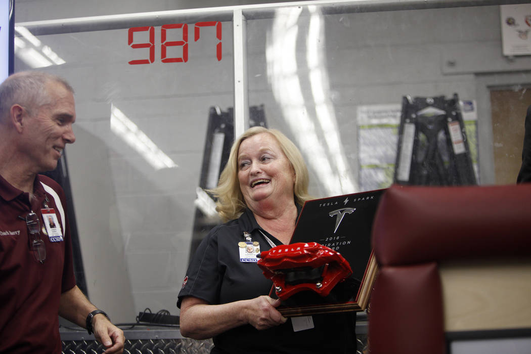 Cimarron-Memorial Principal Lori Sarabyn receives the 2018 Tesla Spark Inspiration award next to robotic Coach Joe Barry at an event where Tesla and education leaders revealed new opportunities fo ...