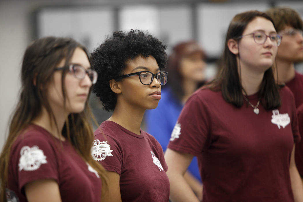Team 987 High Rollers members Miranda Tantlinger, 17, from left, Alicia Harris, 16, and Aspen Anderson, 17, listen at an event where Tesla and education leaders revealed new opportunities for robo ...