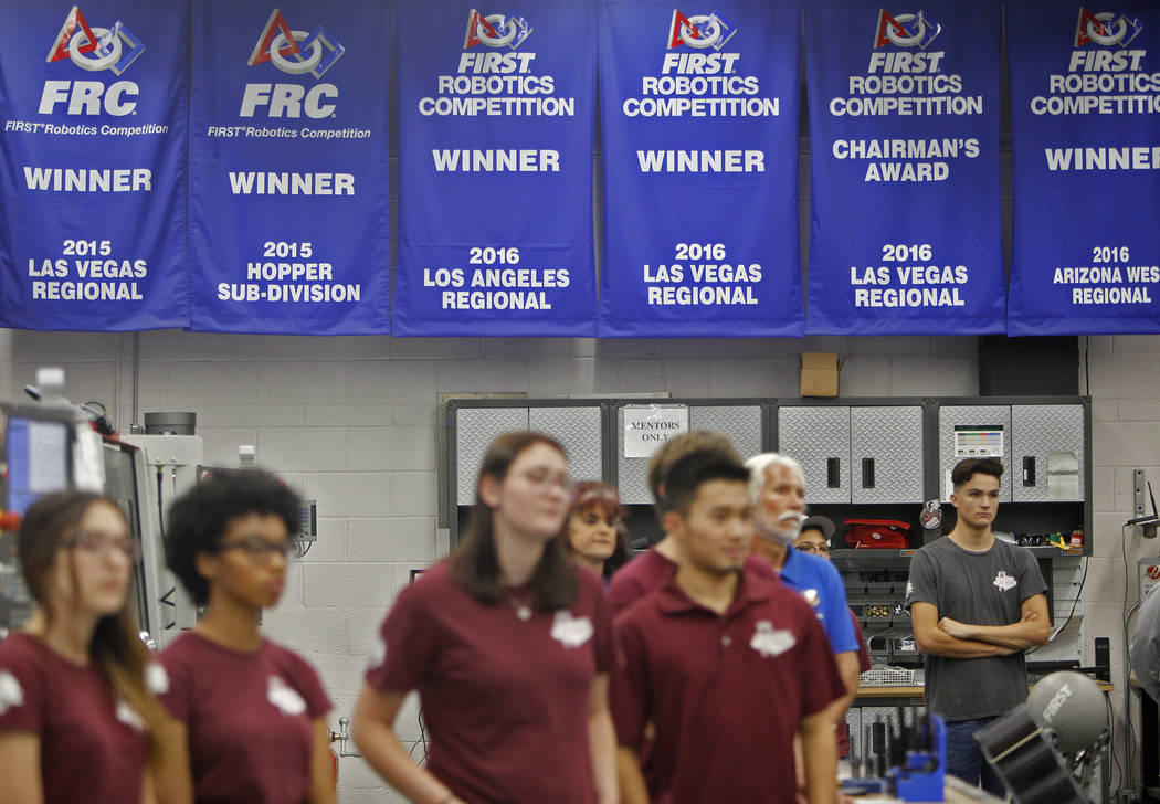 Banners from past years where Cimarron-Memorial's robotics team won hang on the wall at an event where Tesla and education leaders revealed new opportunities for robotics for education throughout ...
