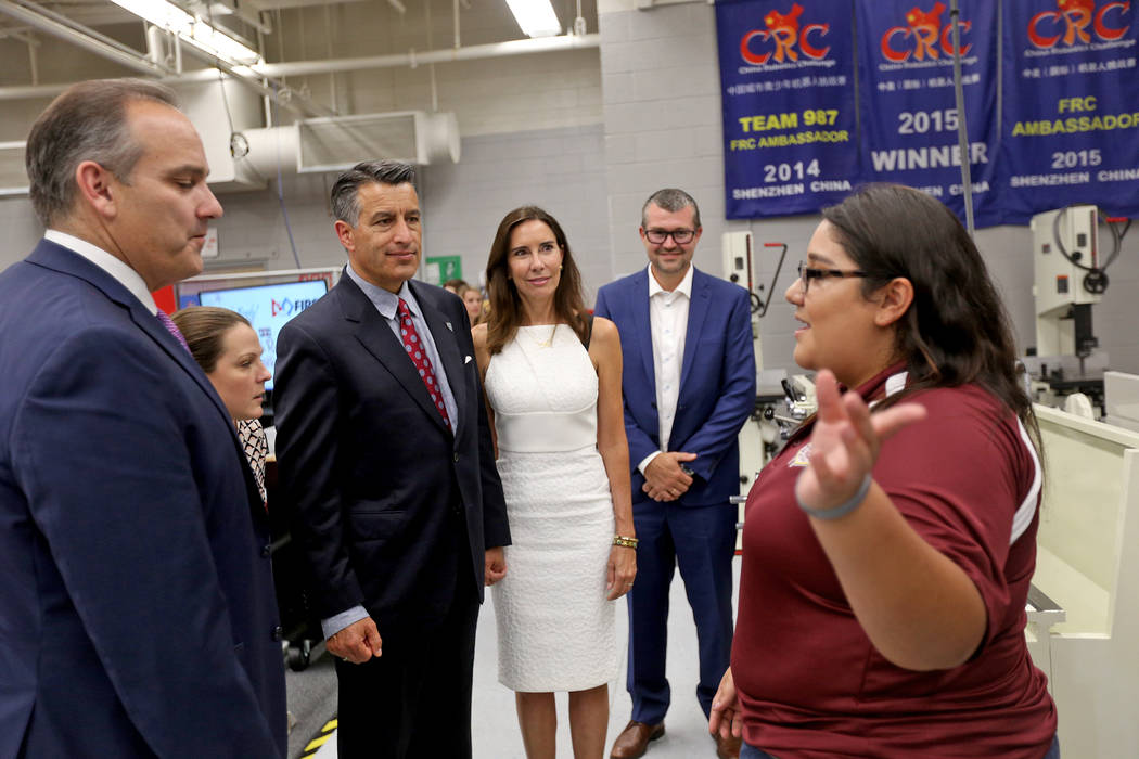 Melanie Sanchez leads a tour of Cimarron-Memorial's robotics program for Clark County School District Superintendent Jesus Jara, from left, CCSD Trustee Lola Brooks, and Gov. Brian Sandoval with h ...