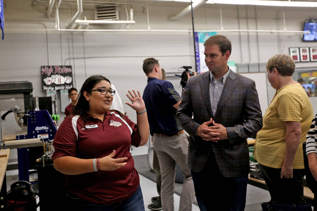 Melanie Sanchez leads a tour of Cimarron-Memorial's robotics program at an event where Tesla and education leaders revealed new opportunities for robotics for education throughout the state at Cim ...