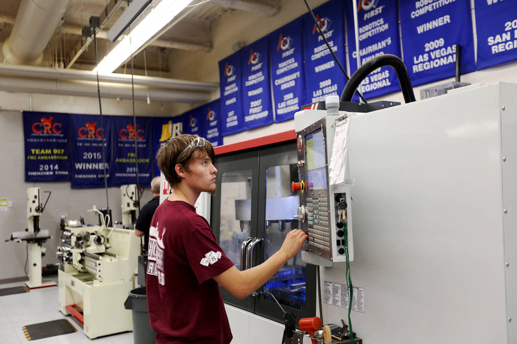 Jackson Haney, 17, operates a computer numeric controlled mill at an event where Tesla and education leaders revealed new opportunities for robotics for education throughout the state at Cimarron- ...