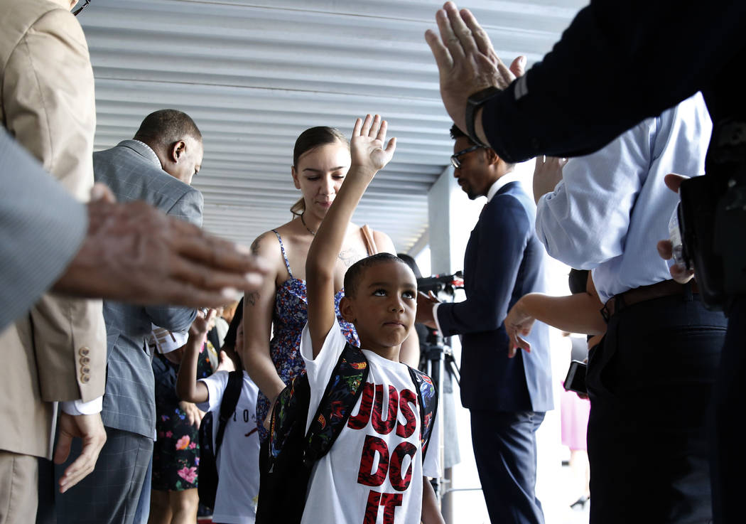 Matt Kelly Elementary School student Kahrmyne Young, 6, welcomed by community and business leaders with an inspirational welcome and red carpet as he arrives on his first day of school on Monday, ...