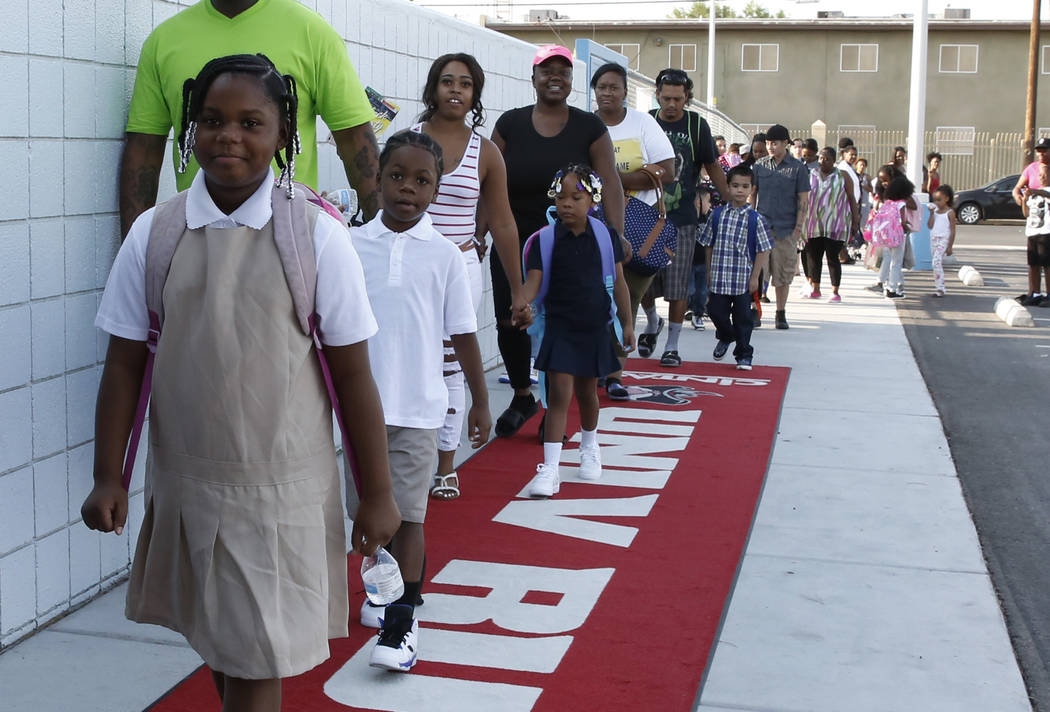 Matt Kelly Elementary School students and their parents walk on the red carpet as they arrive on the first day of school on Monday, Aug. 13, 2018, in North Las Vegas. Bizuayehu Tesfaye/Las Vegas R ...