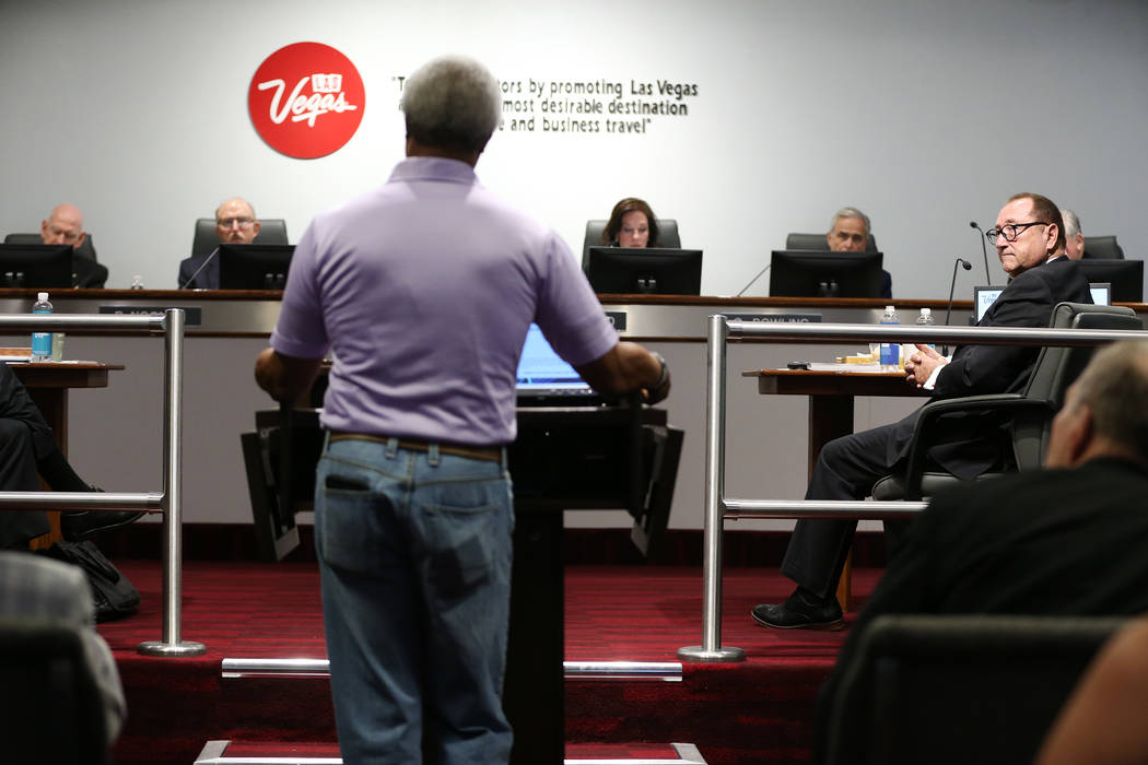 Retiring Las Vegas Convention and Visitors Authority CEO Rossi Ralenkotter, right, listens to public comment during a board meeting at the Las Vegas Convention Center in Las Vegas, Tuesday, Aug. 1 ...