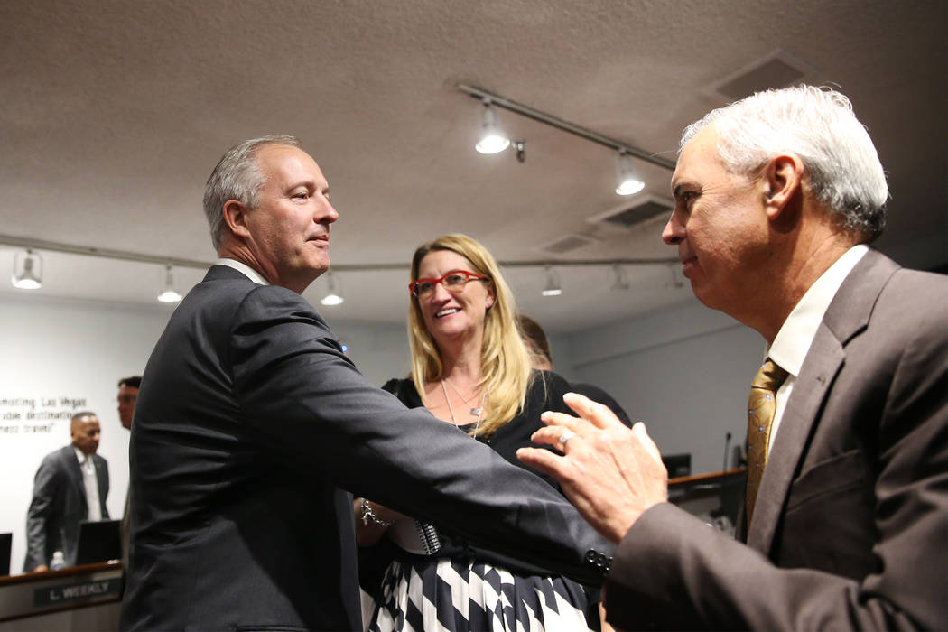 Steve Hill, left, who was named the new CEO of the Las Vegas Convention and Visitors Authority to replace retiring Rossi Ralenkotter, not pictured, shakes hands with Terry Miller of Cordell Corp., ...