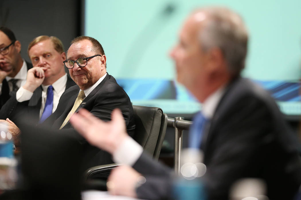 Retiring Las Vegas Convention and Visitors Authority CEO Rossi Ralenkotter, left, listens to Steve Hill, who was named the new CEO of the LVCVA, during a board meeting at the Las Vegas Convention ...
