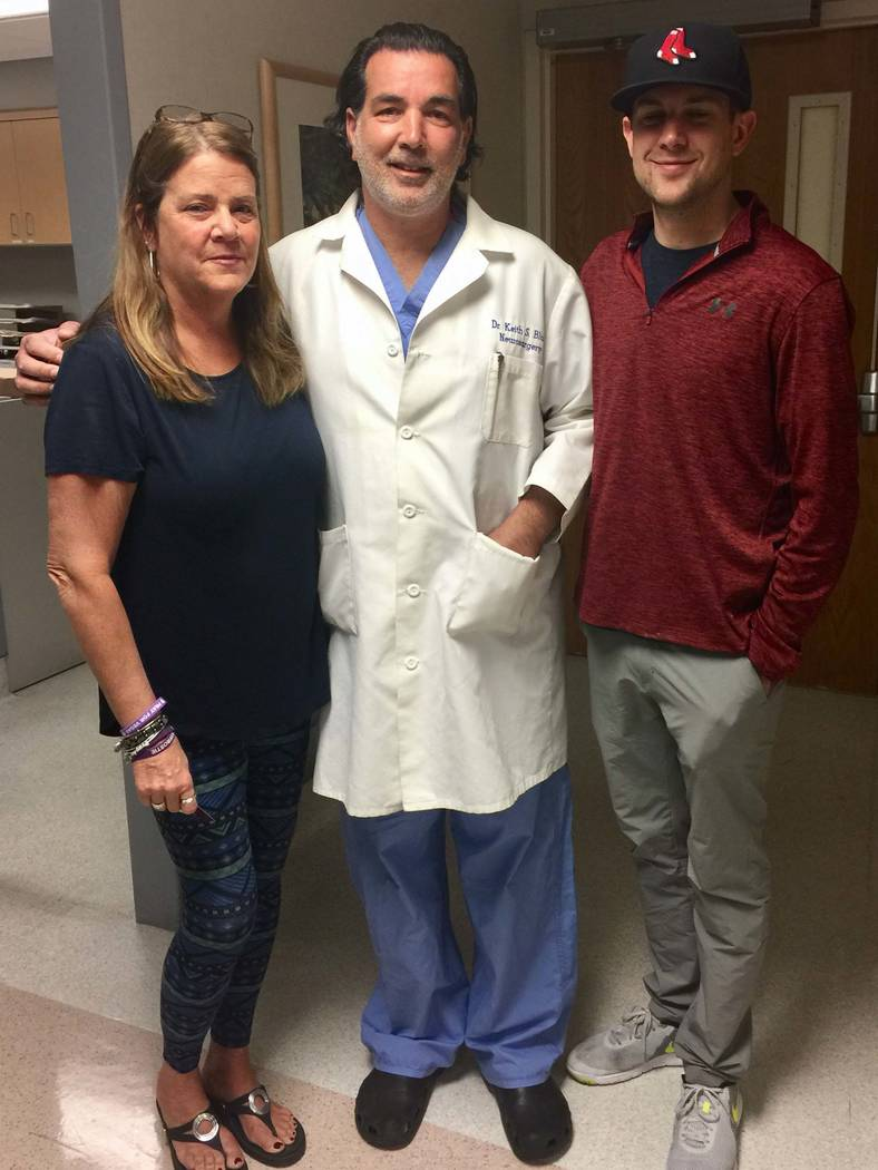 Mary Moreland, Tina Frost's mother, and Austin Hughes, her boyfriend, say goodbye to Dr. Keith Blum at Sunrise Hospital and Medical Center before Frost is transferred to John Hopkins University ...