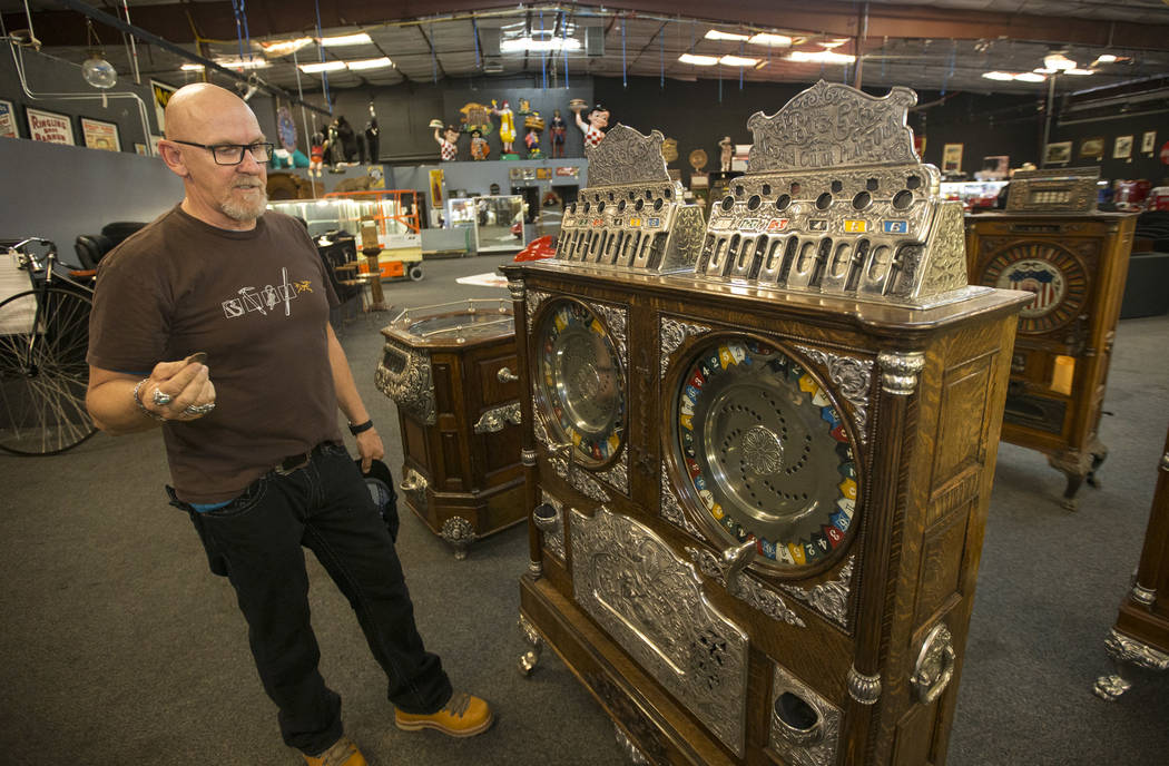 Don Grimmer, vice president of Morphy Auctions, demonstrates the Cailli Bros. 50 cent, Big Six double upright slot machine on display at the company's warehouse located at 4520 Arville Street in L ...