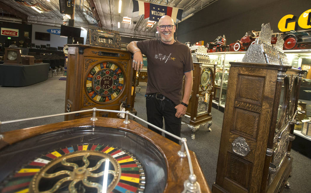 Don Grimmer, vice president of Morphy Auctions, next to a row of vintage slot machines at the company's warehouse located at 4520 Arville Street in Las Vegas on Thursday, Aug. 16, 2018. Richard Br ...
