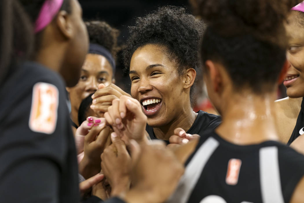Las Vegas Aces forward Tamera Young (1) celebrates with teammates after defeating the Indiana Fever 92-74 in a WNBA basketball game at the Mandalay Bay Events Center on Saturday, Aug. 11, 2018. Ri ...