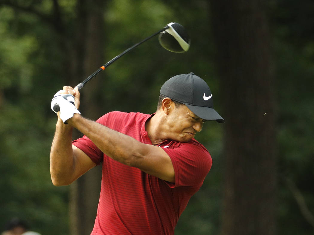 Tiger Woods reacts to his drive on the 17th hole during the final round of the PGA Championship golf tournament at Bellerive Country Club, Sunday, Aug. 12, 2018, in St. Louis. (AP Photo/Charlie Ri ...