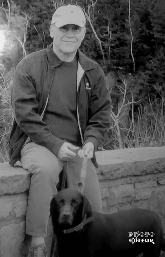 Peter Mansky poses with his chocolate lab (Family photo).