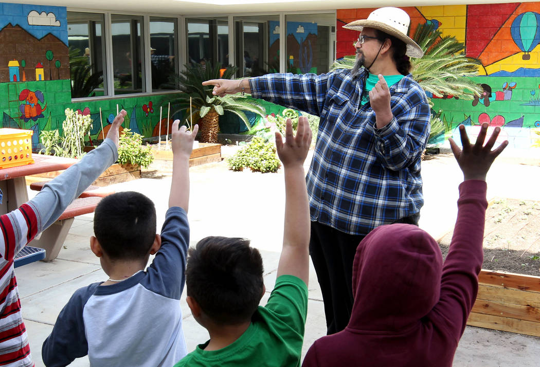 Enrique Garcia with Garden Farms teaches third-grade students at Woolley Elementary School in the Las Vegas school's garden Monday, Feb. 12, 2018. K.M. Cannon Las Vegas Review-Journal @KMCannonPhoto