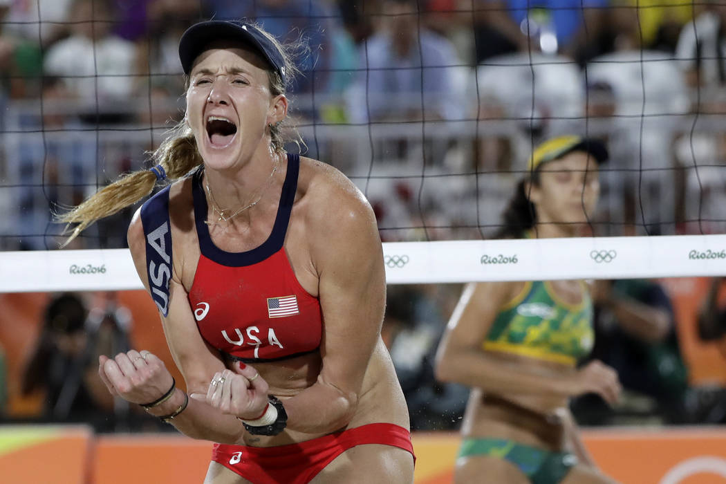 In this Aug. 17, 2016 file photo, United States' Kerri Walsh Jennings reacts while playing Brazil during the women's beach volleyball bronze medal match of the 2016 Summer Olympics in Rio de Janei ...