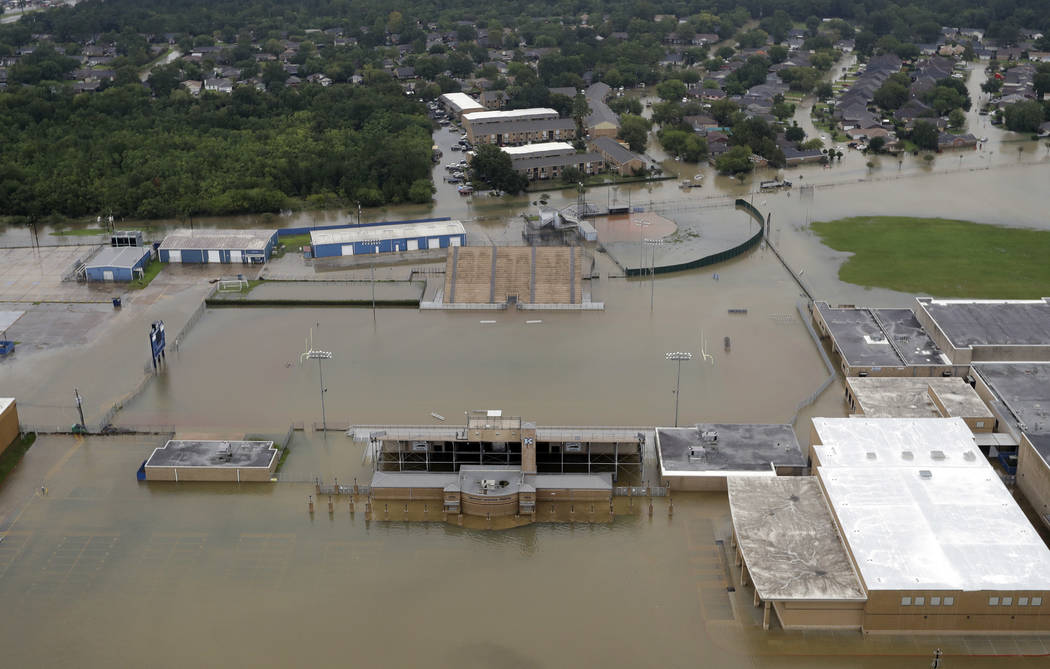 C.E. King High School's football field is covered by floodwaters from Tropical Storm Harvey Tuesday, Aug. 29, 2017, in Houston. (AP Photo/David J. Phillip)