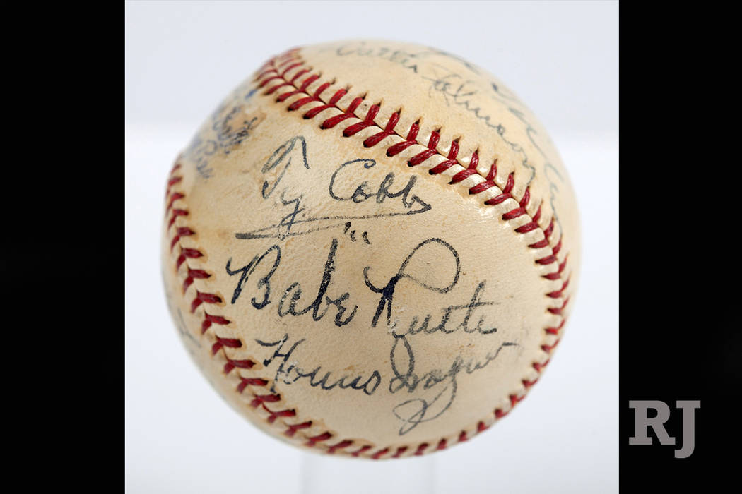 In this undated photo provided by SCP Auctions is a baseball with the signatures of Babe Ruth, Ty Cobb, Honus Wagner and eight other legends of the game that has sold for more than $600,000. The p ...