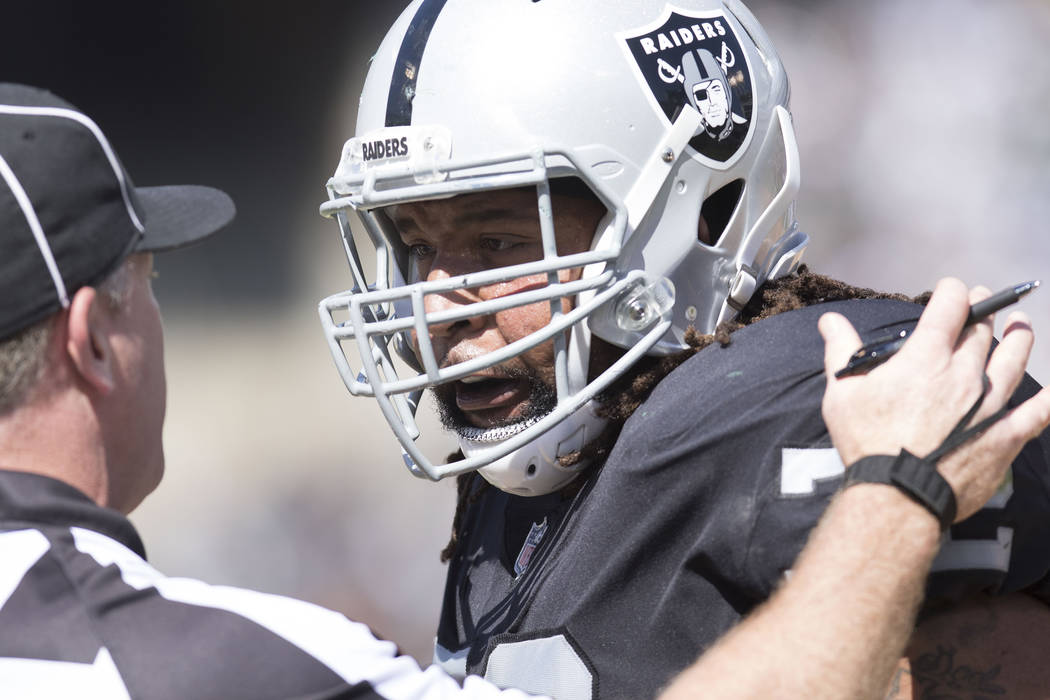Oakland Raiders offensive tackle Donald Penn (72) with a referee during in the first half of their game against the New York Jets in Oakland, Calif.., Sunday, Sept. 17, 2017. Heidi Fang Las Vegas ...