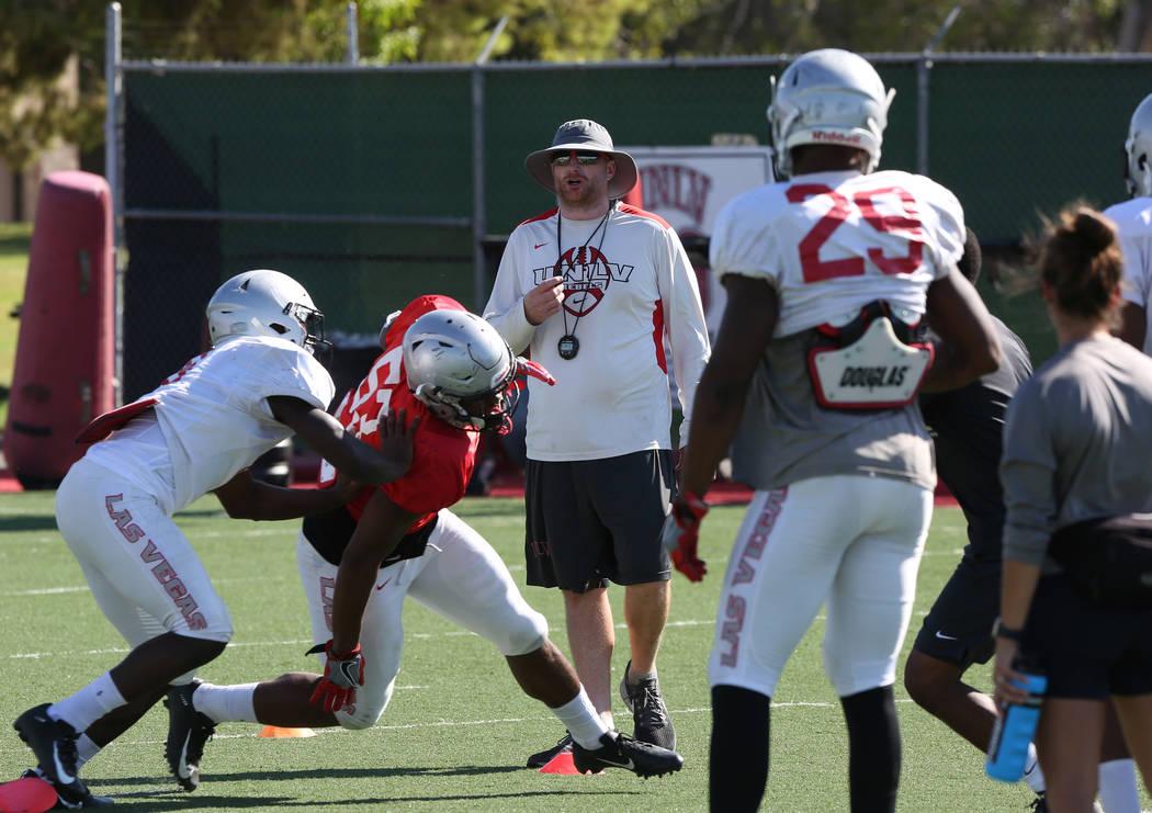 Travis Burkett, UNLV special teams coordinator, watches his players during team practice on Tuesday, Aug. 21, 2018, in Las Vegas. (Bizuayehu Tesfaye/Las Vegas Review-Journal) @bizutesfaye