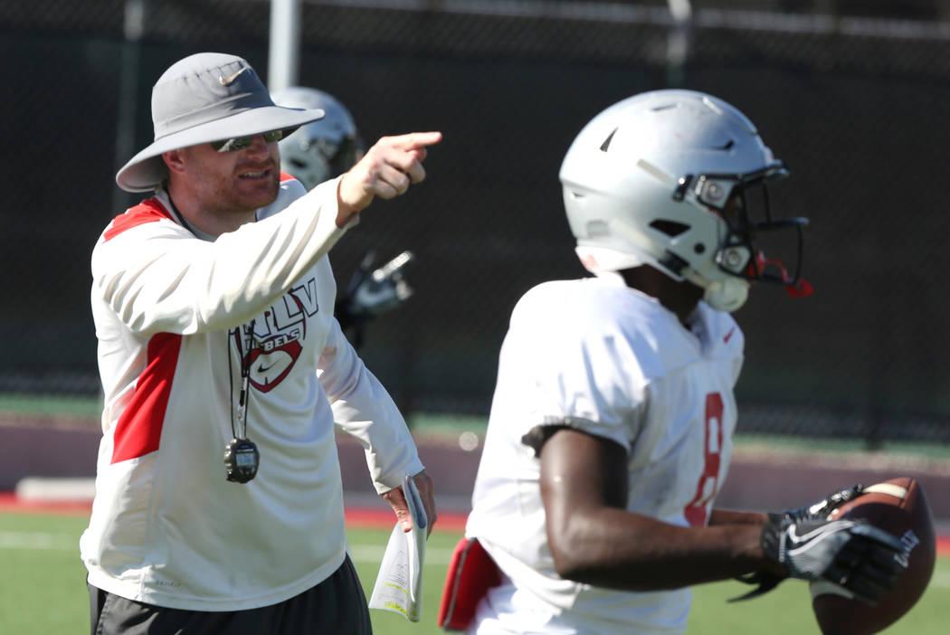 Travis Burkett, UNLV special teams coordinator, directs running back Charles Williams (8) during team practice on Tuesday, Aug. 21, 2018, in Las Vegas. (Bizuayehu Tesfaye/Las Vegas Review-Journal) ...